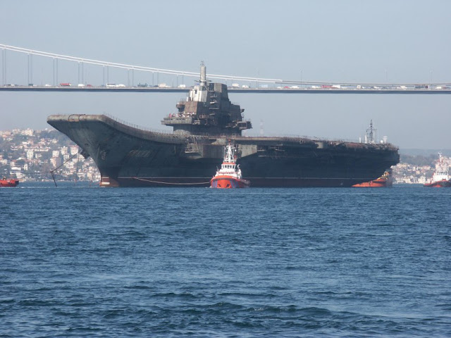 Varyag towed by tugs crossing the Bosporus Strait