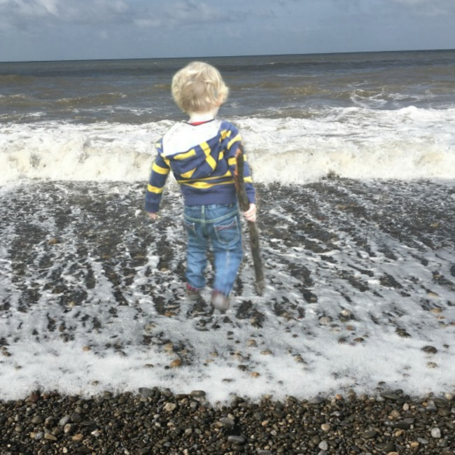 picture-of-toddler-standing-in-the-sea