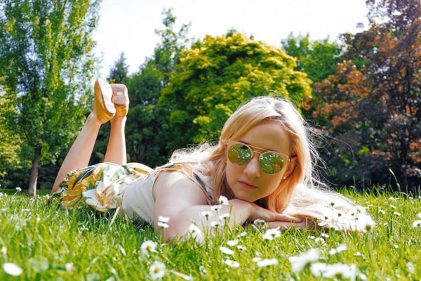 laying in a flower field