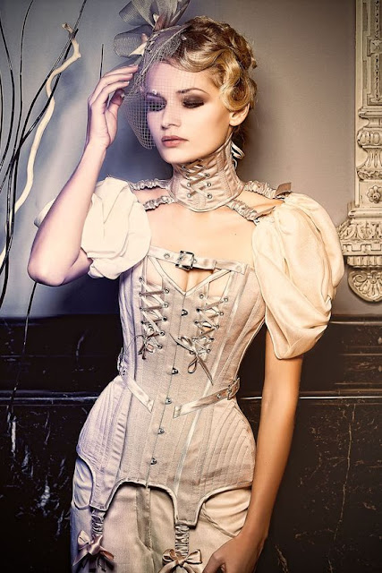 women's neo-victorian steampunk corset with neck collar corset and birdcage veil fascinator. Victorian haute couture high fashion clothing.