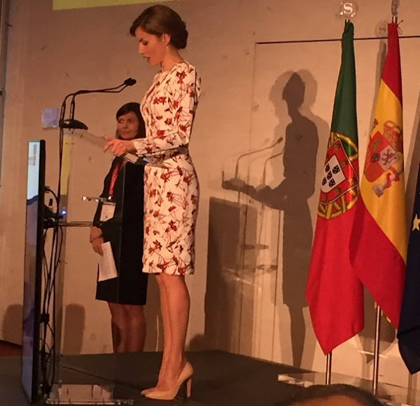 Queen Letizia wore Zara wool coat in red, Carolina Herrera Floral Dress and Lodi Saray Pumps at European Conference in Porto