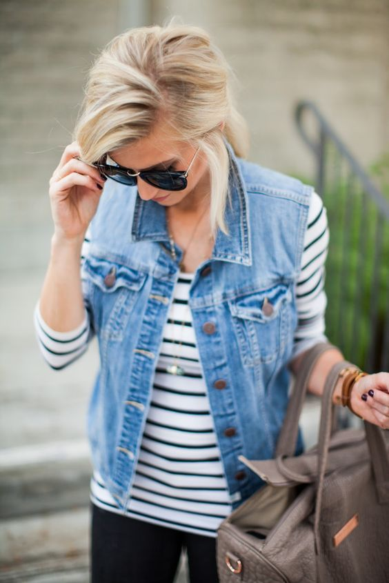 how to style a denim vest : stripped top + bag + black skinnies