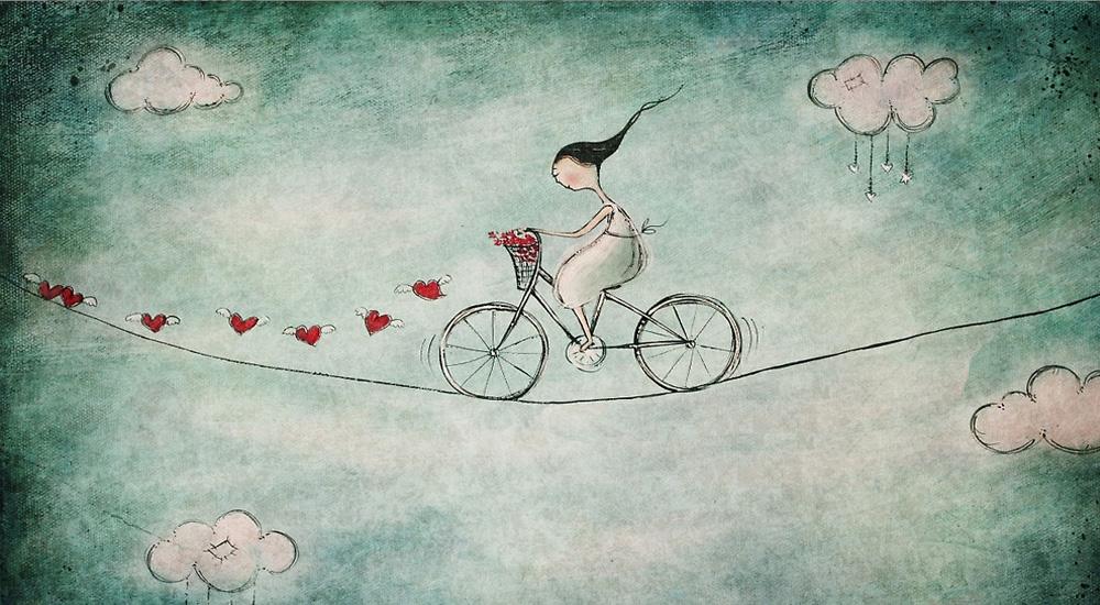 Mujer en bicicleta cuerda floja