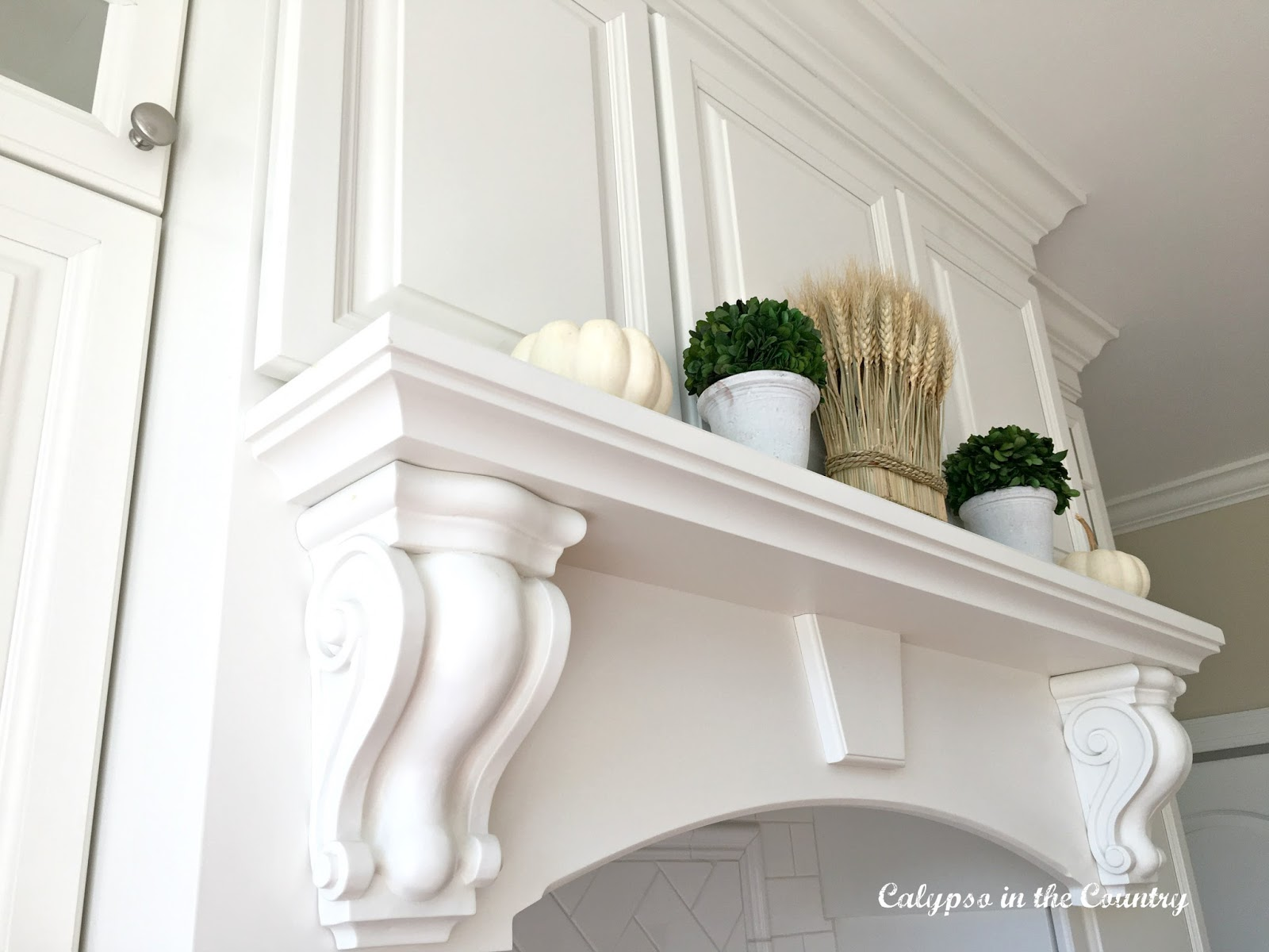 White Stove Mantel with white pumpkins
