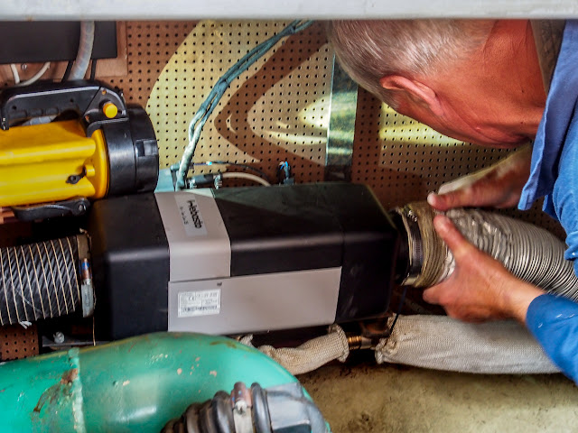 Photo of Phil checking the pipes on our Webasto 5 diesel heater