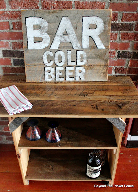 rustic farmhouse table and vintage bar sign