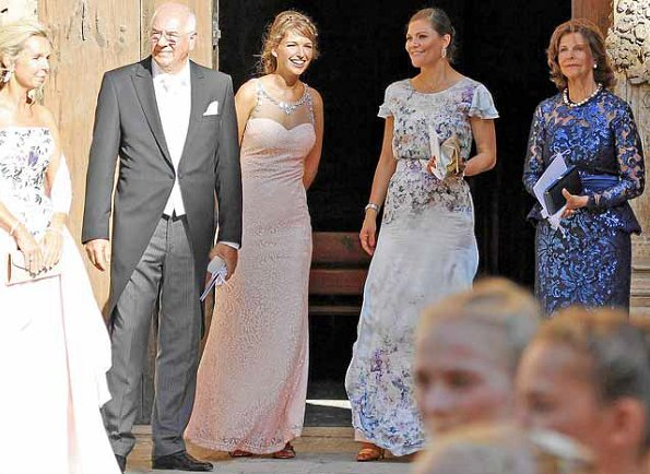 Princess Victoria wore VALERIE lace gown for Helena Christina Sommerlath and Ian Martin's wedding.