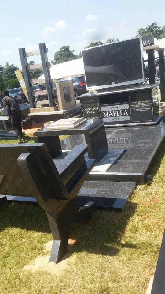 Image result for Joe Mafela's Tombstone,One Of It's Kind,Fitted With LCD TV,Table & Chair For Special Mourners