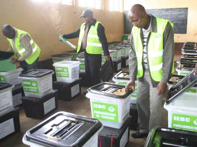 IEBC officials inspect ballot boxes at Muguru ACK Church hall ahead of their use at a Kangema polling station in the March 4, 2013 general elections. /JESSE MWANGI