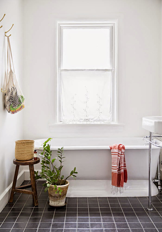 Wooden bathroom stool | Image by Brittany Ambridge via Domino