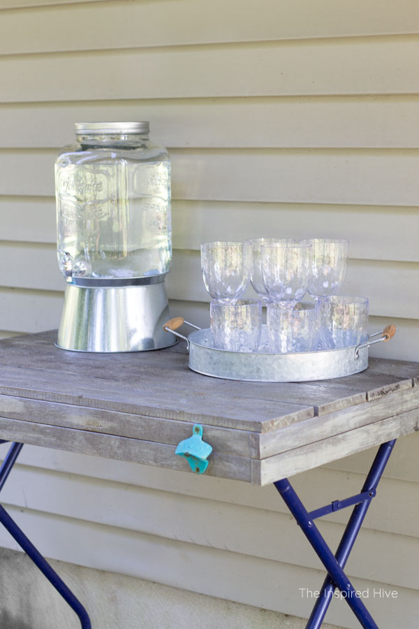 DIY Outdoor bar cart perfect for entertaining. Use a tray to hold cups and glasses.