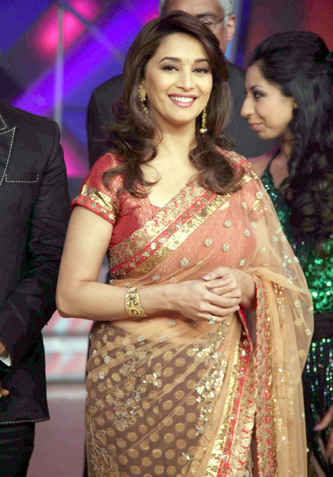 Madhuri Dixit Latest Stills In Red Transparent Saree