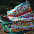 Baby Quilt Features Big Prints Mixed with a Liberated Style