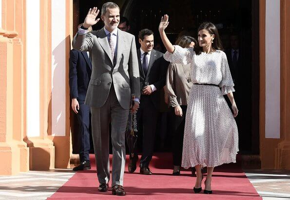 Queen Letizia wore Emporio Armani Crepon long dress with polka dot jacquard motif. Doñana Natural Park in Almonte