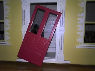 Broken door on the doll's house