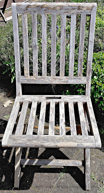 shows old teak wood chair before restoring