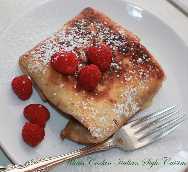 these are a fried flour tortilla filled with raspberry filling or pie filling or your choice with rasberries on top. Sprinkled with powdered sugar and on a elegant plate to serve guests