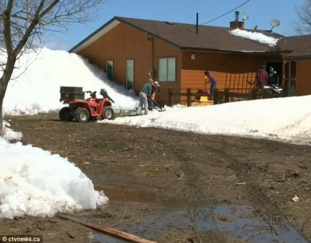 Homeless: Canadian officials were at work Saturday helping the community dig out of the ice and to find shelter for those left homeless by the floe