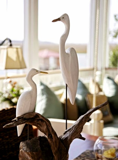carved wood egrets