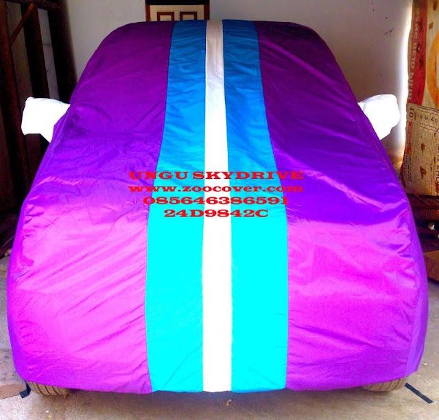 Jual Cover Mobil Ungu Skidrive custom menggunakan bahan yang bagus waterproof import korea Sarung Mobil kualitas super kombinasi warna Selimut Mobil harga murah produk terbaik penutup mobil dan pelindung mobil anda dari debu, panas matahari, tahan air dan panas