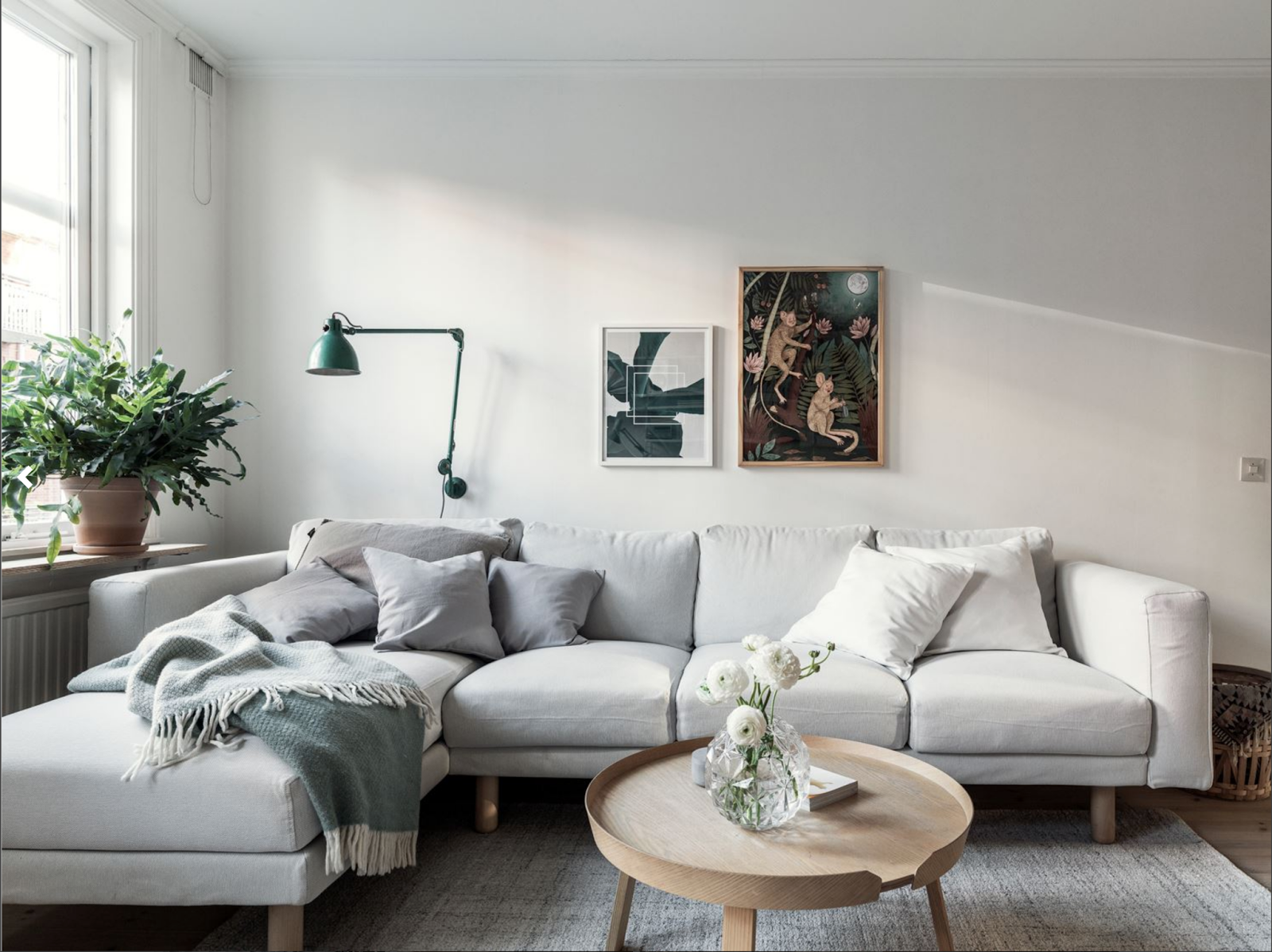 gray sofa and seafoam lamp in a small nordic apartment