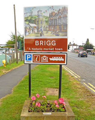 The welcome to Brigg sign alongside the A18 on Bridge Street, including the boating emblem - picture on Nigel Fisher's Brigg Blog