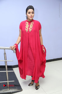 Actress Poorna Latest Stills in Red Dress at Rakshasi First Look Launch  0312.JPG