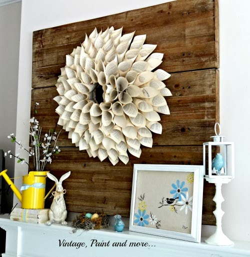 Spring Mantel - faux pallet board, book page wreath, watering can, spring flowers