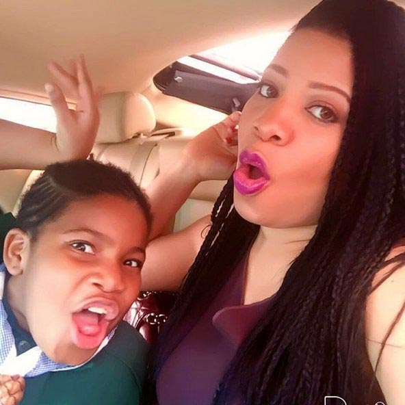 Monalisa Chinda poses with her daughter while taking her to school