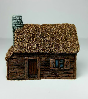 Thatched Timber-clad Cottage