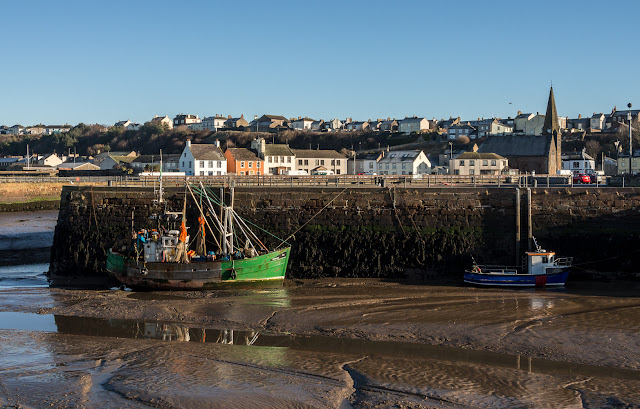 Photo of fishing boats in Maryport Harbour at low tide