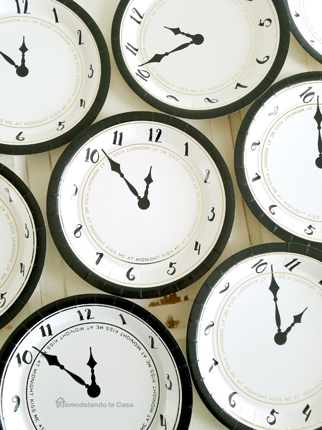 black and white and gold paper plates in a clock design with numbers to 12