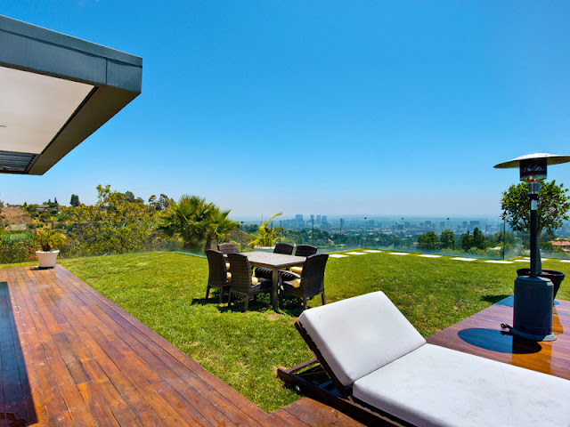 Photo of outdoor furniture on the lawn in the backyard of modern Bel Air residence