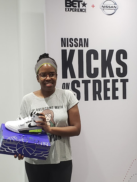 A Kicks on the Street raffle winner with her Nike Just Don Legacy 312 sneakers
