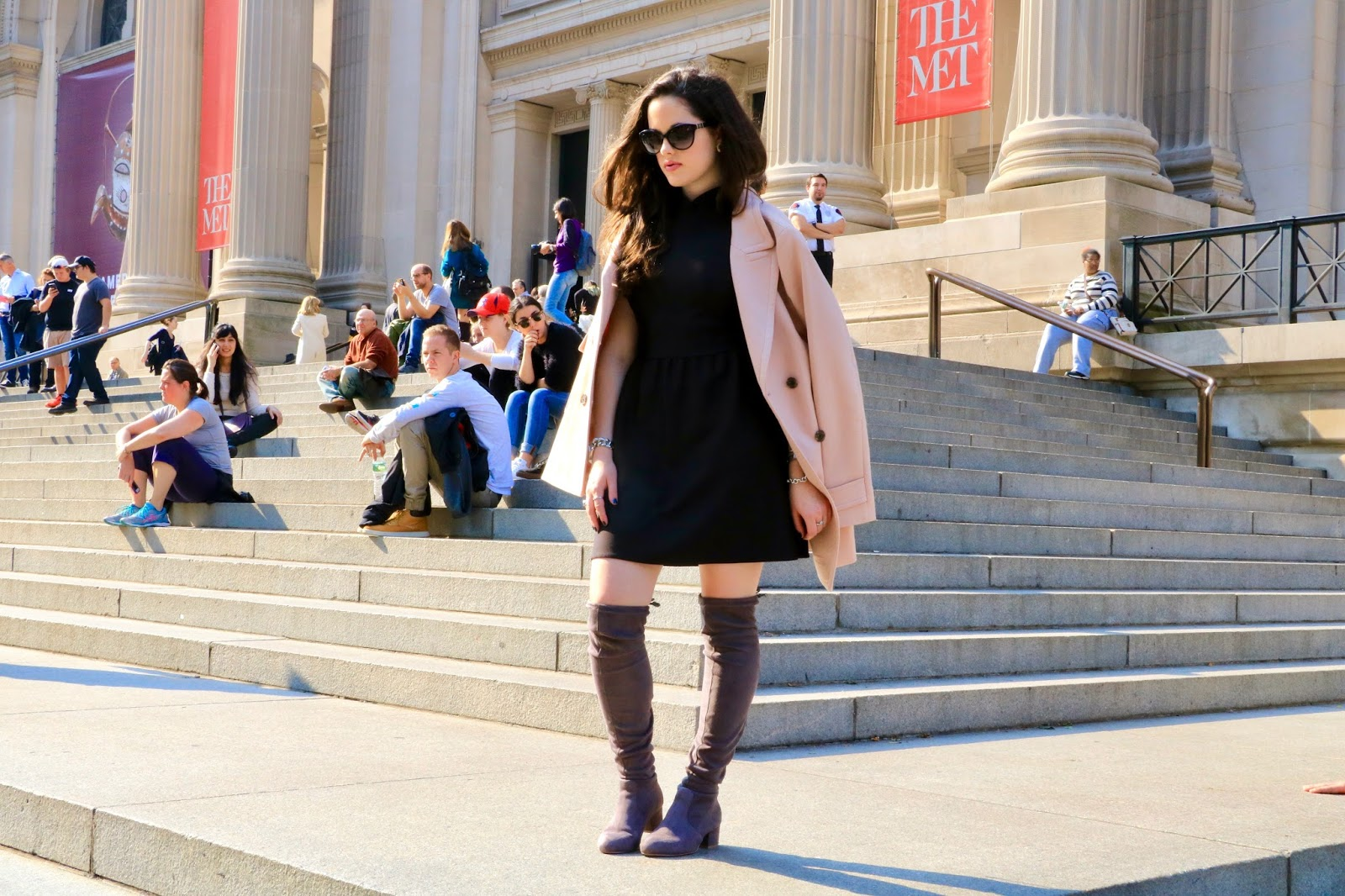 fashion blogger steps at the met