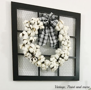 Vintage, Paint and more... a gorgeous farmhouse cotton boll wreath made with a cotton garland and black and white check fabric bow on a wonderful screened window frame.
