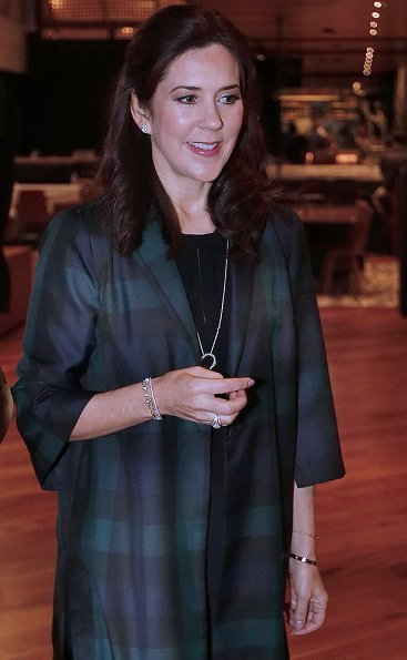 Crown Princess Mary wore a woven checked jacket by Baum und Pferdgarten. Crown Princess Mary is visiting Texas
