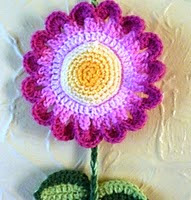 http://www.ravelry.com/patterns/library/colourful-flower-hanging