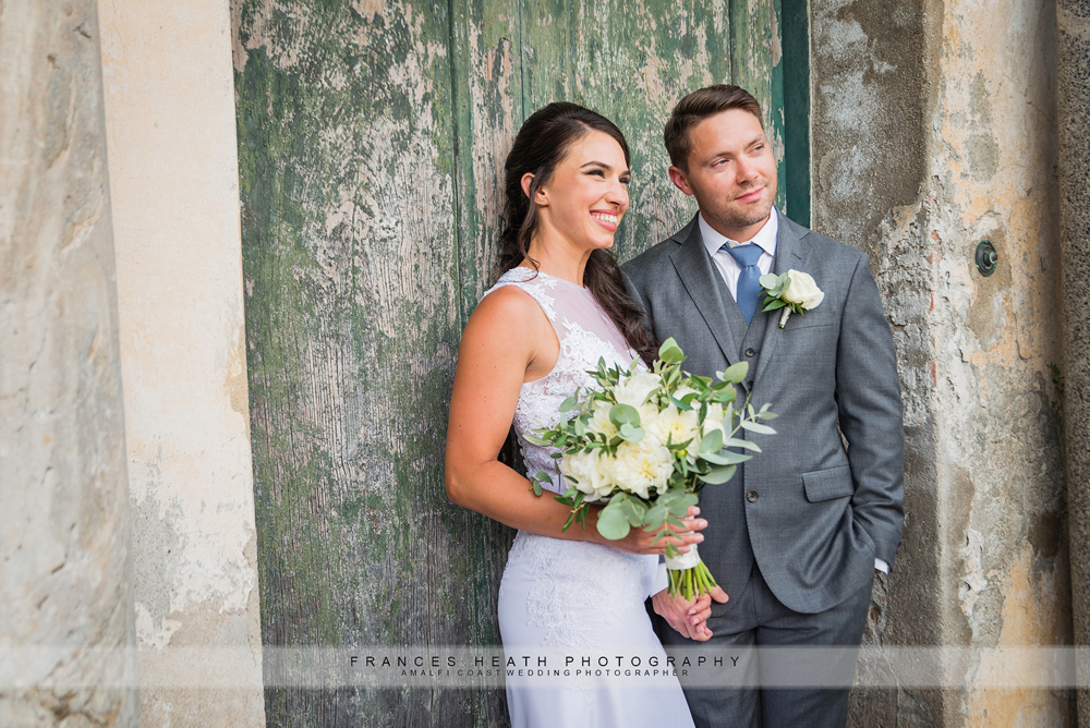 Bride and groom portrait in Ravello infront of green door