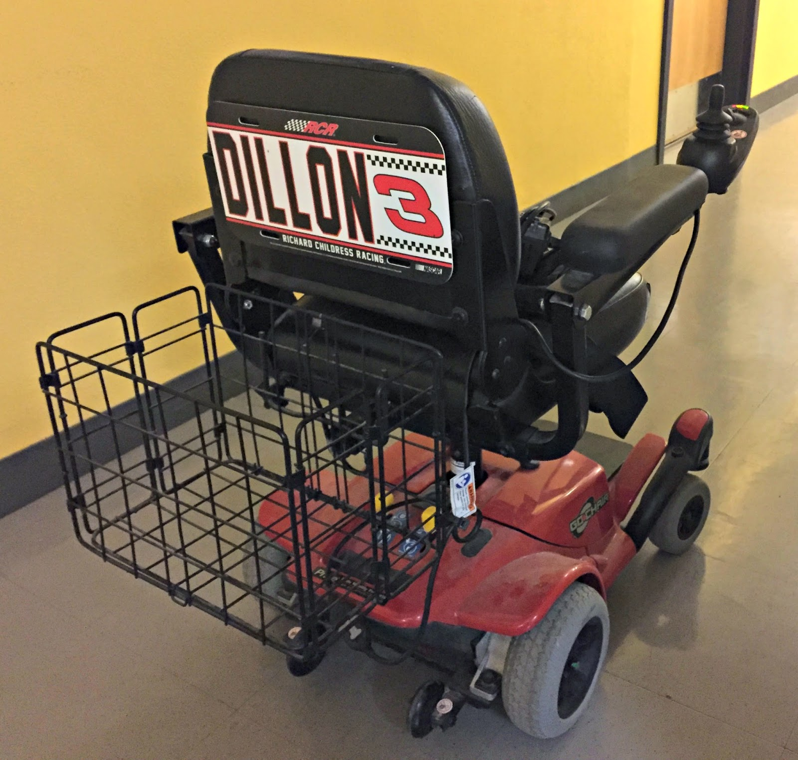 Dillon's refurbished power wheelchair complete with awesome Dillon racing sticker.
