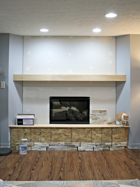 built in electric fireplace with hearth