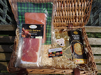 hamper filled with salmon and cheese in the sun