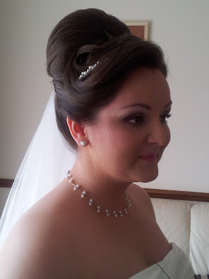 High sophisticated wedding hair by Louise Chrystal