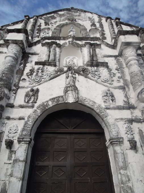 The door and intricate arch of Daraga Church