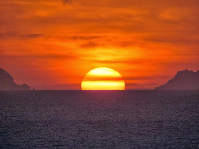 sunrise today between Desertas islands, in a view from Funchal city