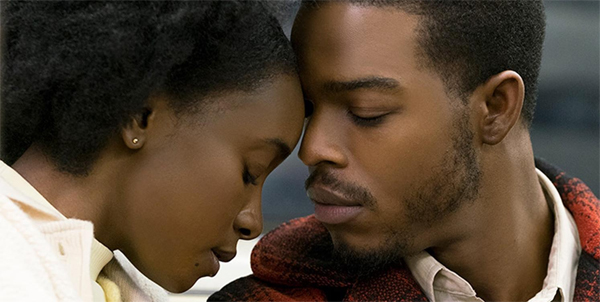 image of Tish (KiKi Layne) and Fonny (Stephan James), a young Black woman and man, nuzzling their faces together in a screenshot from 'If Beale Street Could Talk'