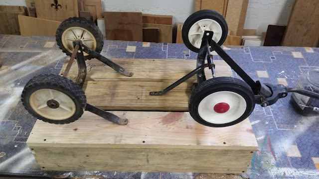 secure a set of wagon wheels to the pallet box
