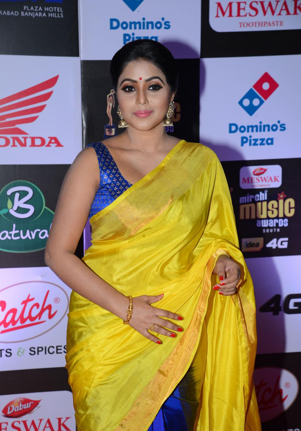 Actress Poorna Hot Stills At Mirchi Music Awards In Yellow Saree