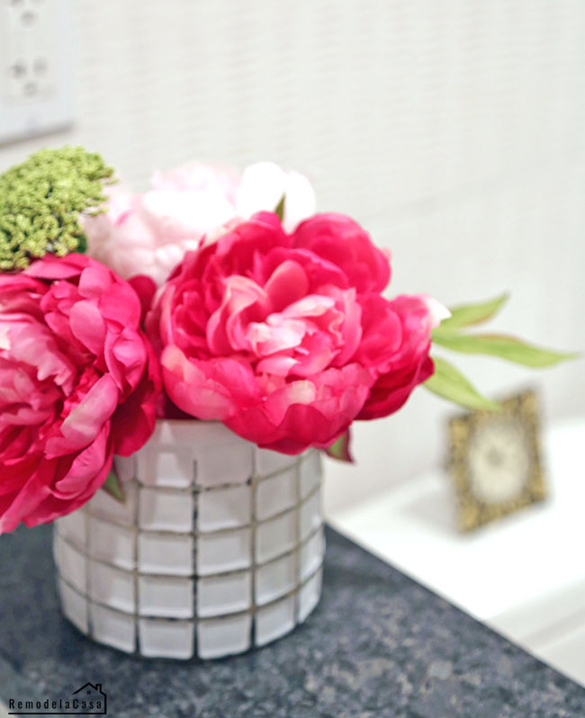 Gorgeous bouquet of peonies in bath counter