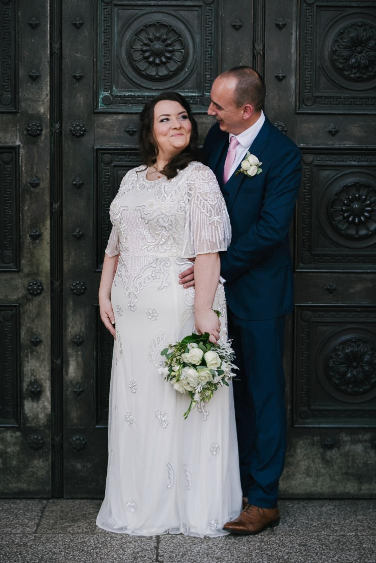 This is a picture of a bride and groom outside the national museum wales